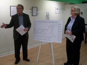Ben Dunlap, left, and Barbara Darkes, of the Central Pennsylvania LGBT Community board of directors explaining the center's membership program.